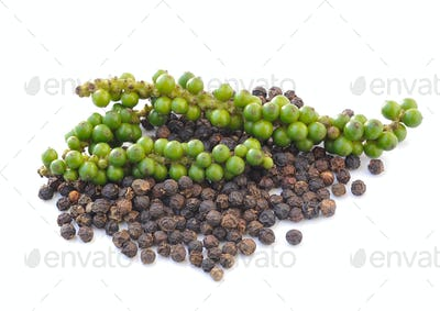 Black peppercorn and Bunches of fresh green pepper isolated on w