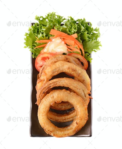 onion rings on a plate on white background