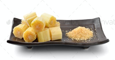 sugar cane on black plate