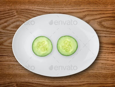 Cucumber in the white plate  on wooden table