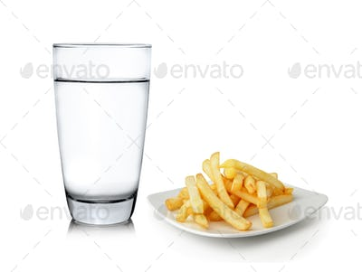 Glass of water and French fries isolated on white background