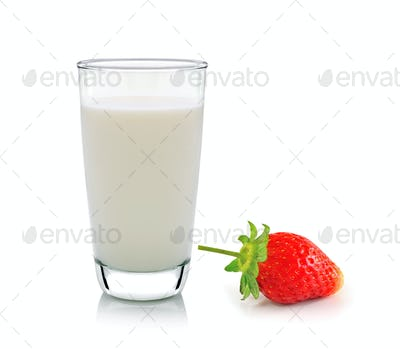 glass of milk and strawberry on white background