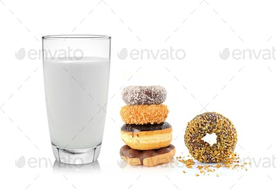 glass of milk and donut isolated on white background