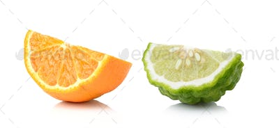 Half orange fruit and bergamot white background, fresh and juicy