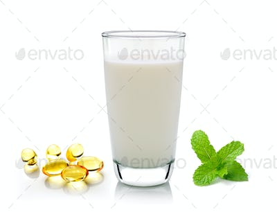 glass of milk mint and fish oil  isolated on white background
