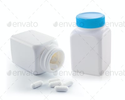 white bottle with pills isolated on white