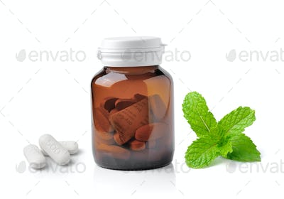 Medicine bottle of brown glass pill and mint  isolated on white