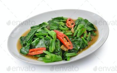 Thai food fried kale with crispy pork