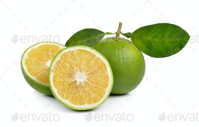 Fresh sweet orange with leaves on white background