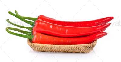 Red chili pepper in the basket isolated on a white background