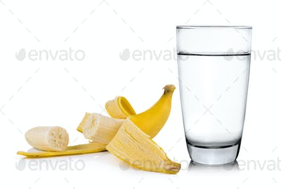 Glass of water and banana isolated on white background
