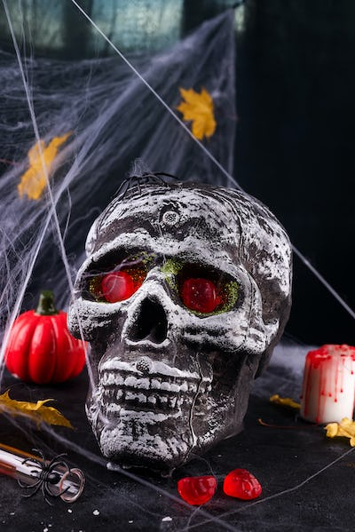 Happy Halloween Party Table with spider web and skull