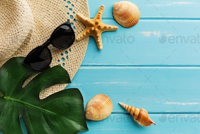 Vacation background on blue wood, top view with copy space