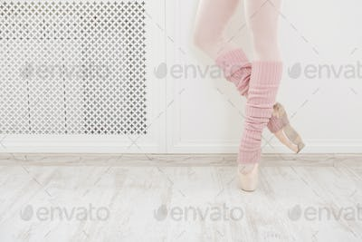 Legs of ballet dancer wearing gaiters closeup