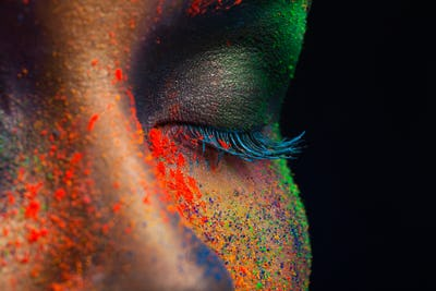 Eye of model with colorful art make-up, close-up