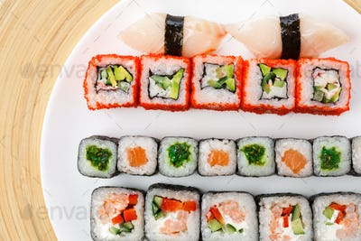 Colorful set of sushi and rolls top view, closeup