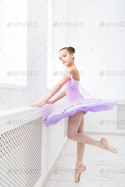 Ballet student exercising in ballet costume