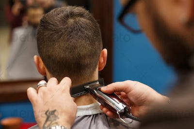 Man getting haircut by hairstylist at barbershop