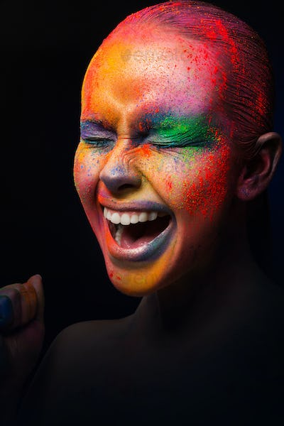Beauty with colorful make-up, dark background
