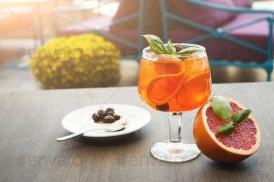 Modern serving of italian spritz with orange slices