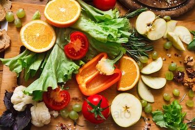 Pattern of fresh vegetables on wood background