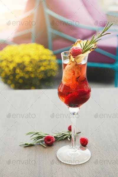 Alcohol cocktail against blurred interior background