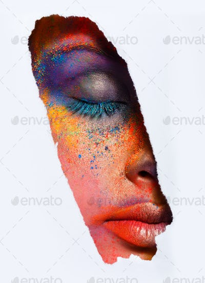 Face of model with colorful art make-up, close-up