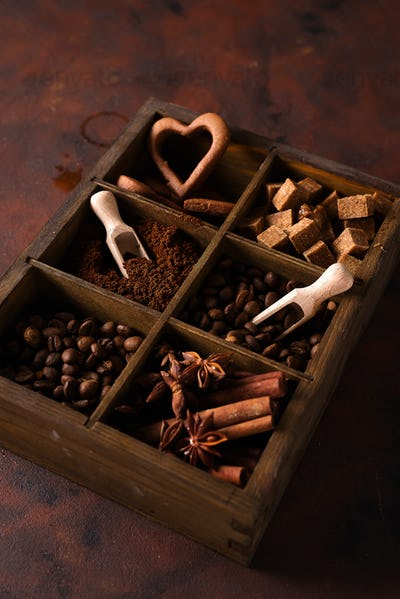 Spices, coffee and cookies in wooden box