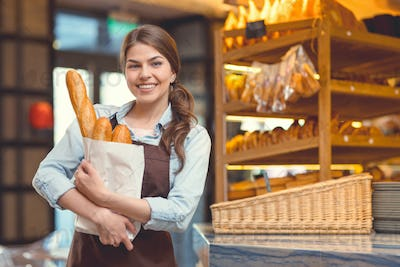 Young woman with baguettes