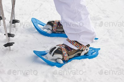 Snow rackets and boots equipment on the snow. Winter sports