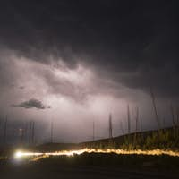 Monsoon Rains Fall From Storm Clouds Generating Lightning