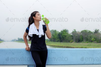 Girl with drinking in park