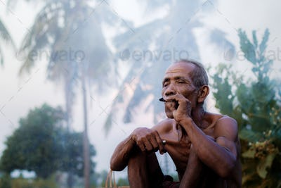 Asian men are smoking in countryside