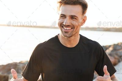 Portrait of a smiling sportsman celebrating success