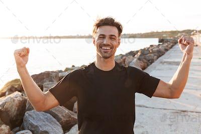 Portrait of a cheerful sportsman celebrating success