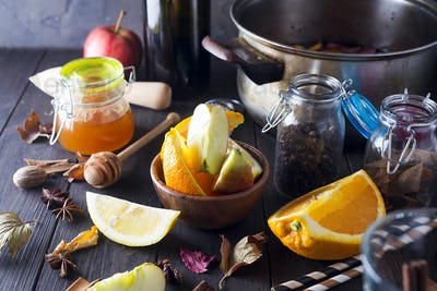 Christmas mulled wine and ingredients on dark wooden background