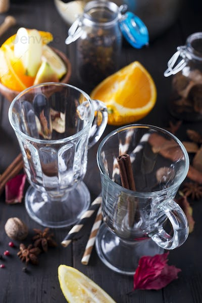 Christmas mulled wine ingredients and glass on dark wooden background