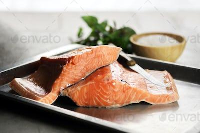 Fillet of salmon fish on metal plate closeup