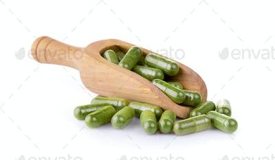 Moringa capsules in the scoop