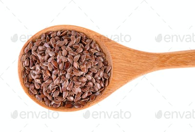 Flax seeds heap in wood spoon isolated on white background