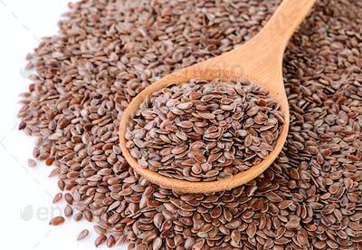 Flax seeds heap in wood spoon