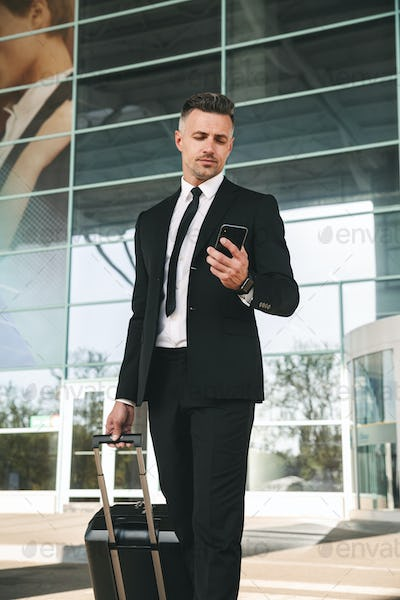 Handsome businessman dressed in suit walking