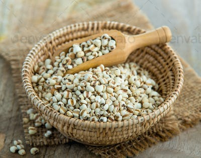 Millet the organic grain food in basket on wood table