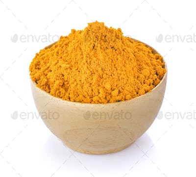 turmeric in wood bowl on white background
