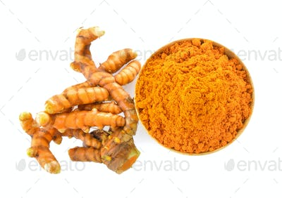 turmeric root and dry tumeric in wood bowl on white background