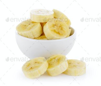 slice banana in bowl on white background