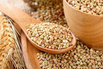 Buckwheat in wood spoon on table