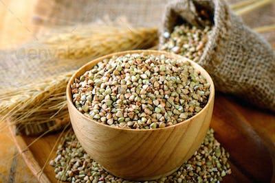 Buckwheat in wood bowl on table