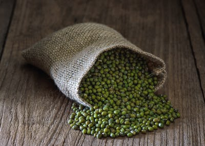 green gram or mung bean in sacks on table