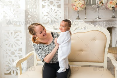 Loving Mother Holding Mixed Race Baby Boy At Home
